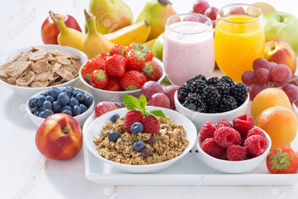 41845847-Delicious-and-healthy-breakfast-with-fruits-berries-and-cereal-on-wooden-tray-Stock-Photo